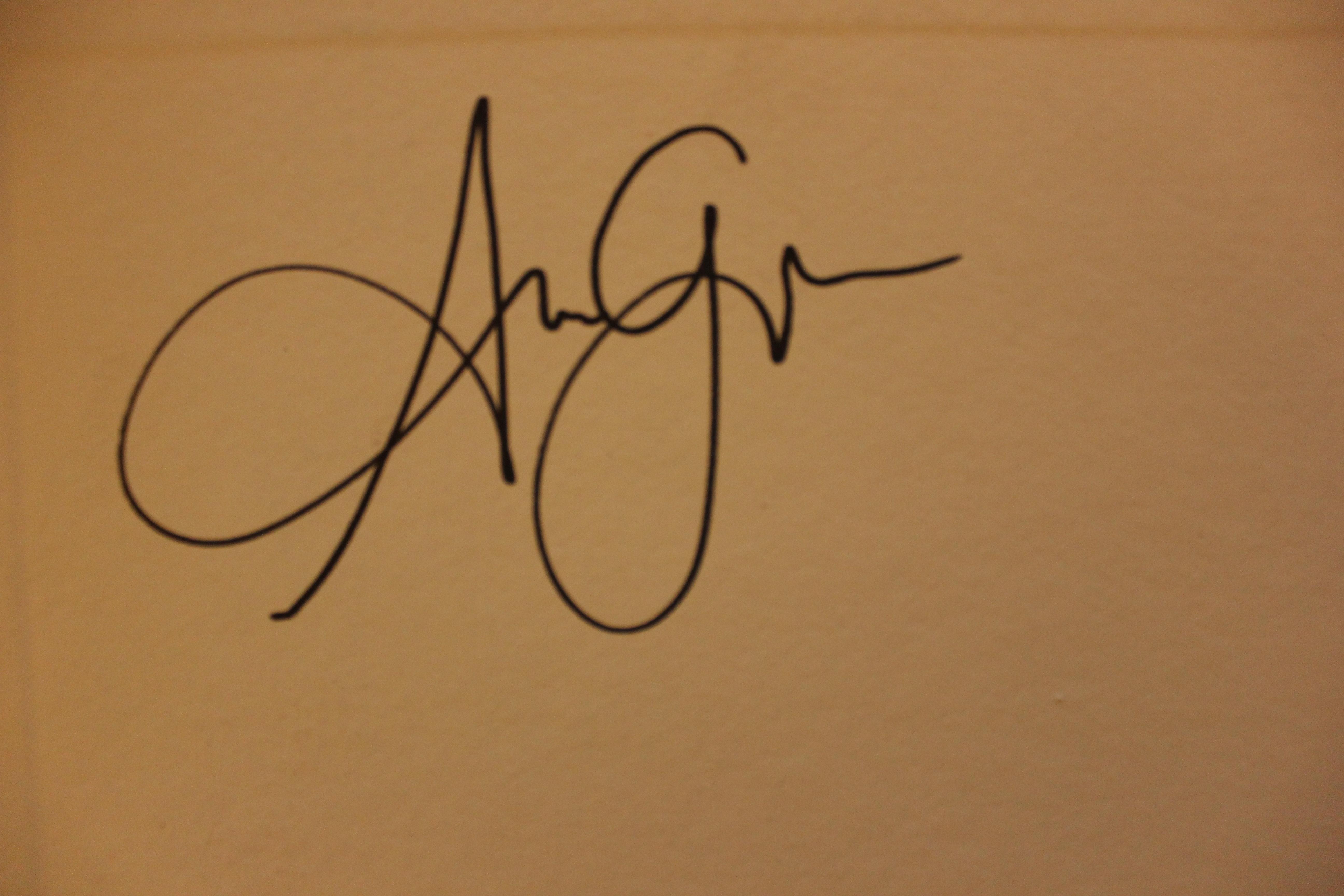 greg norbert Adotevi owondot Signature